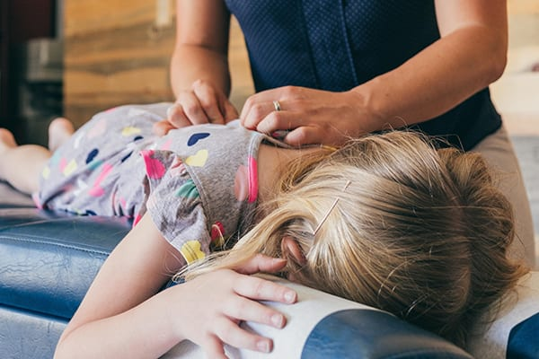 our Kitsilano chiropractor help young age adjust their back