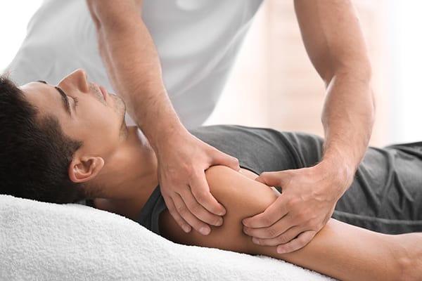our Kitsilano message therapist help male relax his muscle pain